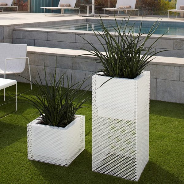 Perforated Ferrum planters in white in pool area